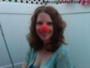 Jenna in her clown nose at the carnival party.  Clown noses make a fun party favor or game prize idea.