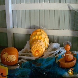 This is an Awesome Pumpkin Carving.  It is an Igloo and an Eskimo in his boat.