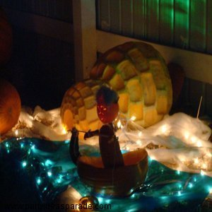 Here's another view of the Amazing Pumpkin Carving.  It's the Igloo and the Eskimo in his boat all lit up.