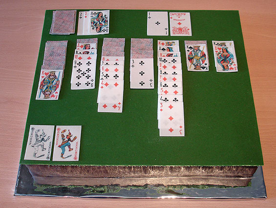 This Homemade Cake looks like a card table that has a game of solitaire being played on it.