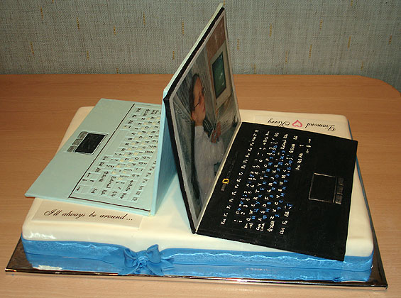 Look at this Computer Cake Design.  This fondant Lap Top cake is really amazing.