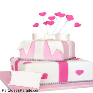 Fondant Cake with heart cut out shapes.  Look what you can do with fondant.  You can make a beautiful fondant cake like this one.