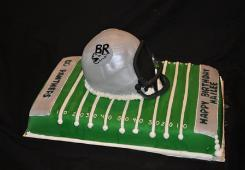 Football Helmet and Field Cake made with fondant by Blue Sheep Bake Shop in Metuchen, New Jersey.