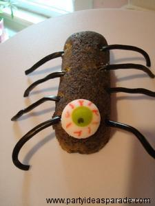 Here is a picture of a Spider Halloween Dessert made from a Twinkie.  Make your own scary party foods, it is easy.
