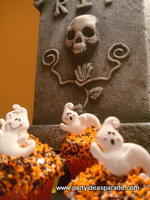 Ghost Cupcake Rings near the Tombstone for a Halloween display