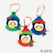 Penguin Ornament Craft Kits are the perfect holiday party activity for a kids party.