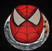 This Spiderman Birthday Cake was made with fondant icing.