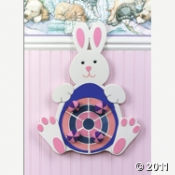 The Easter Bunny Dart Game is played with balls wrapped in velcro like material.  Aim and throw!