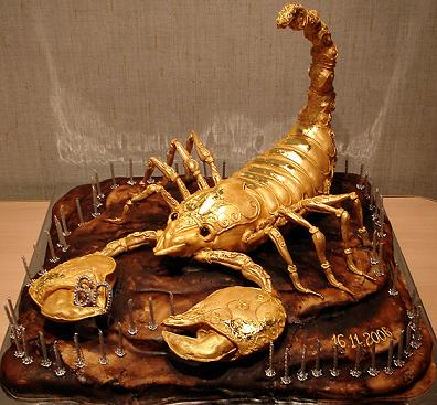 Look at this amazing cake design.  It is a golden  Scorpion cake made with fondant icing.