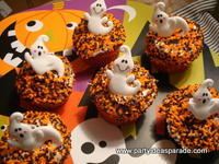 A Bunch of Cupcakes with Ghost Rings.  Easy Halloween Cupcake Ideas!