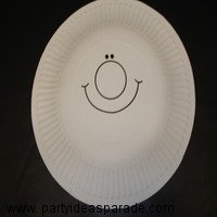 Start off with a paper plate and draw a face on it.