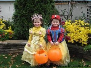 In North America kids like to dress up in costumes.  These Twins are in costume as Snow  White and Belle from Beauty and the Beast!