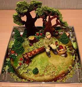 This cake is a man sitting in a forest.  How did the cake designer come up with this idea?