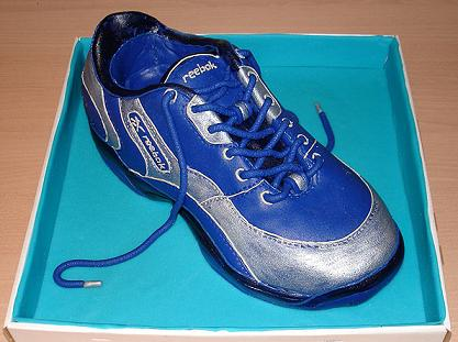 This sneaker cake was made using fondant icing.  You can use our easy marshmallow fondant recipe to make one of your own.