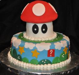 This Super Mario Bros Cake is made with fondant icing.  It was made by the Blue Sheep Bake Shop in New Jersey.